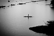 A fisherman glides across the water in the Mekong Delta region of Vietnam.