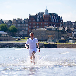 Pictured: Scottish Liberal Democrat leader Willie Rennie MSP runs along the beach at St Andrews.<br /> <br /> <br /> <br /> Ger Harley | EEm date