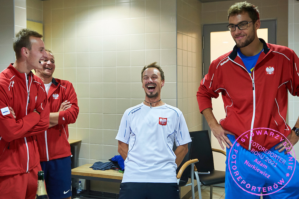 (L-R) Kamil Gajewski and Radoslaw Szymanik - captain national team and Jerzy Janowicz celebrate their victory during Davis Cup Tie World Group Play-off Poland v Slovakia at Gdynia Arena Hall in Gdynia, Poland.<br /> <br /> Poland, Gdynia, September 20, 2015<br /> <br /> Picture also available in RAW (NEF) or TIFF format on special request.<br /> <br /> For editorial use only. Any commercial or promotional use requires permission.<br /> <br /> Adam Nurkiewicz declares that he has no rights to the image of people at the photographs of his authorship.<br /> <br /> Mandatory credit:<br /> Photo by &copy; Adam Nurkiewicz / Mediasport