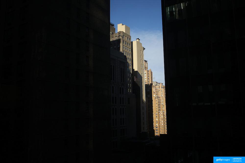 A street scene showing light catching high rise buildings of  Manhattan, New York, USA.  Photo Tim Clayton