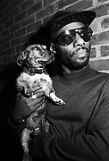 Carl McIntosh of Loose Ends with Dog , London, 1990s.