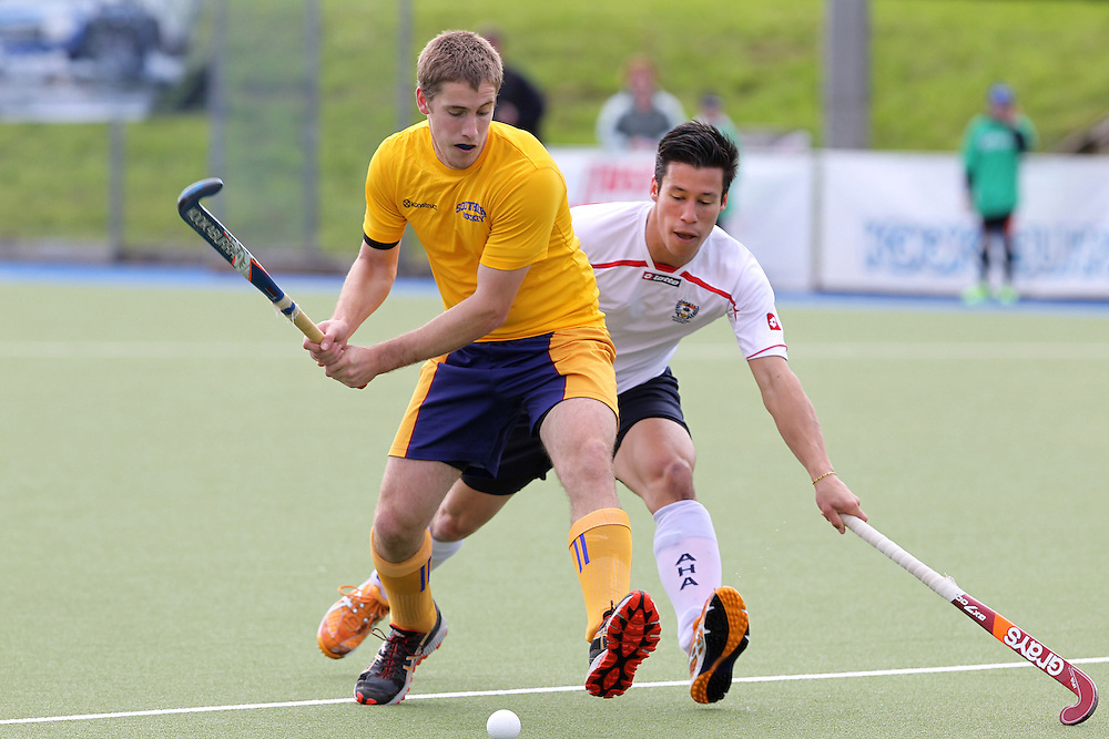 Southern's Matthew Young looks to get past Auckland's Steve O'Connor during the national hockey league final at Lloyd Elsmore Park, Auckland, New Zealand, Sunday, September 02, 2012. Credit:SNPA / Ben Campbell