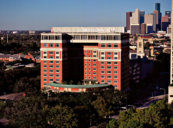 The old Warwick Hotel (now the Hotel ZaZa) in Houston, Texas with the downtown skyline in the distance.