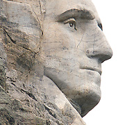 Presidents George Washington. Mount Rushmore National Memorial, is a mountain sculpture of Presidents George Washington, Thomas Jefferson, Theodore Roosevelt and Abraham Lincoln carved into the granite face of Mount Rushmore, Lakota Sioux name: Six Grandfathers, near Keystone, South Dakota. Sculpted by Danish American artist Gutzon Borglum and his son, Lincoln Borglum.    Photography by Jose More