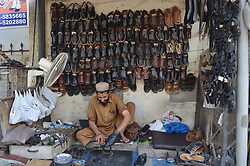 October 4, 2017 - Pakistan - RAWALPINDI, PAKISTAN, OCT 03: Shoe maker busy in mending shoes to earn his livelihood .for support of his family, in Rawalpindi on Tuesday, October 03, 2017. (Credit Image: © PPI via ZUMA Wire)
