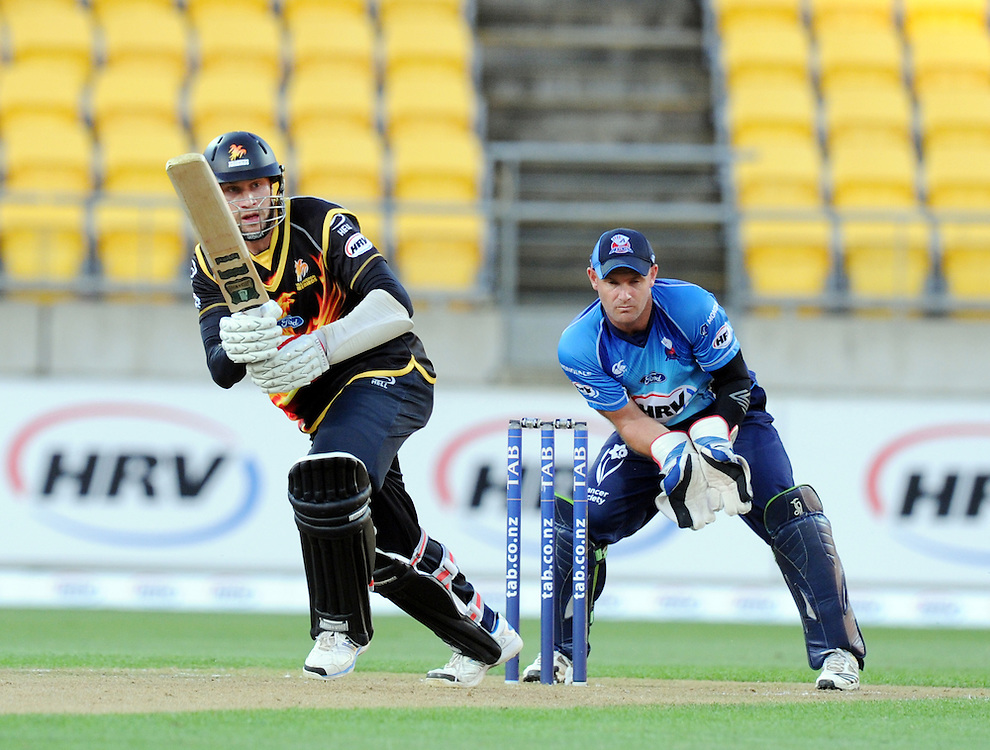 Wellington Firebirds Stephen Murdoch plays in front of Auckland Aces wicket keeper Gareth Hopkins in the HRV T20 cricket match at Westpac Stadium, Wellington, New Zealand, Saturday, November 23, 2013. Credit:SNPA / Ross Setford