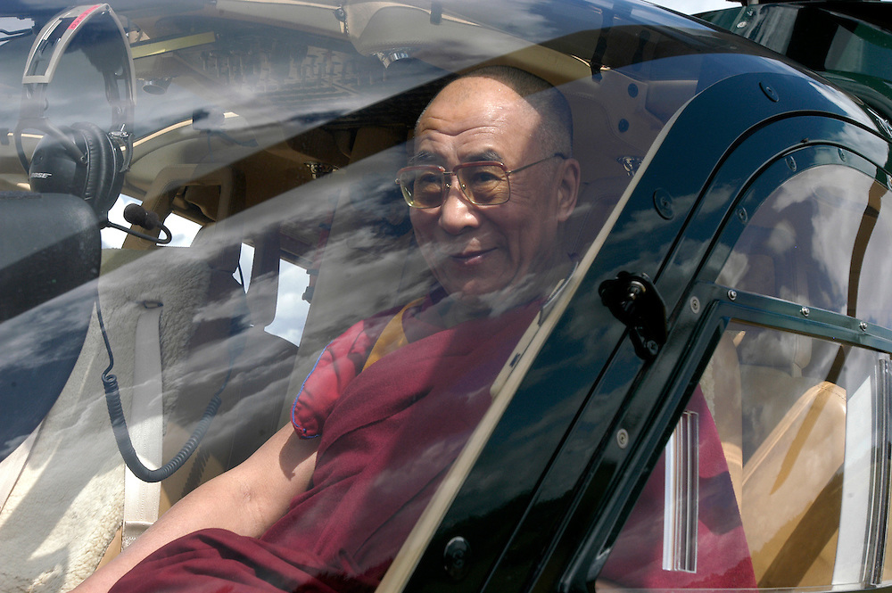 His Holiness the Dalai Lama departing from the Vajradhara Ling Buddhist Temple in Normandie during his His Holiness' visit to France. The Dalai Lama blessed a project to build a Temple for Peace at the center and gave a speech to hundreds of guests...Aubry-le-Panthou, France. 14/08/2008..Photo © J.B. Russell