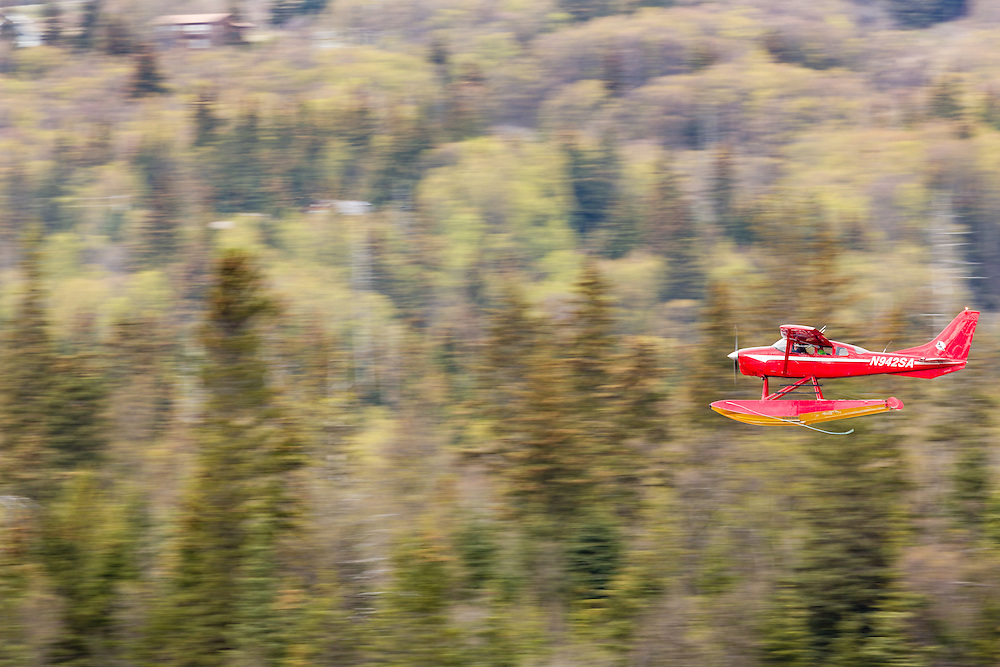 Float plane on approach to landing on Beluga Lake in Homer in Southcentral Alaska. Spring. Afternoon.