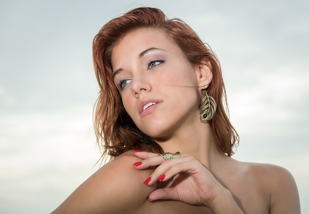 Portrait of red hair caucasian woman looking away