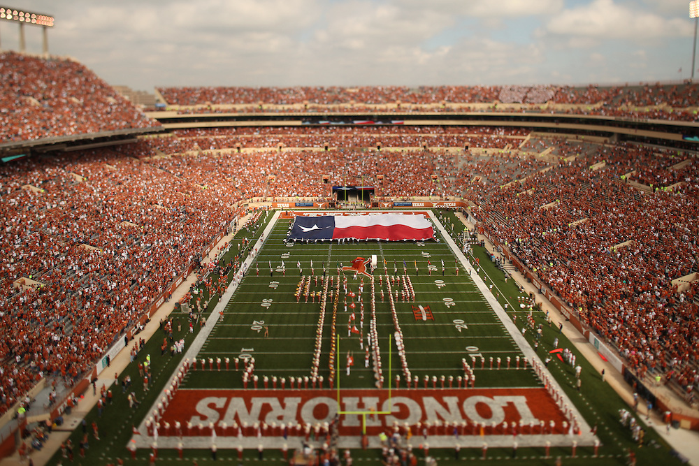 General view of stadium pre-game from south end zone. Longhorn band in T-formation and Texas flag on field, photographed with tilt-shift lens. University of Central Florida Knights at Texas Longhorns. Photographed at Darrell K. Royal-Texas Memorial Stadium in Austin, Texas on Saturday, November 7, 2009. Photograph © 2009 Darren Carroll