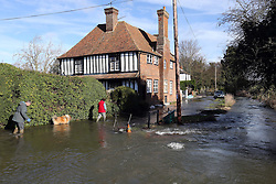 Residents struggle through a flooded road in the village of Patrixbourne,  Kent , United Kingdom. Sunday, 9th February 2014. Picture by Stephen Lock / i-Images