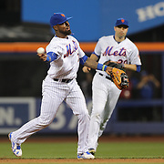 NEW YORK, NEW YORK - July 08: Jose Reyes #7 of the New York Mets, fielding in the shift, makes an out watched by Neil Walker #20 of the New York Mets during the Washington Nationals Vs New York Mets regular season MLB game at Citi Field on July 08, 2016 in New York City. (Photo by Tim Clayton/Corbis via Getty Images)
