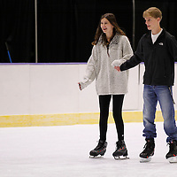 Thomas Wells | BUY at PHOTOS.DJOURNAL.COM<br /> Layne Gerber, 15, left, and Jacob Parker both of Columbus enjoy a Sunday afternoon ice skating date in Tupelo.