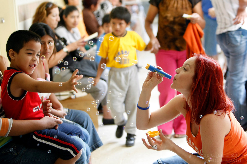 Operation Smile ambassador, Carmit Bachar of the Pussy Cat Dolls, entertains children who are waiting to be seen by the Operation Smile team at the Hospital Japones in Santa Cruz, Bolivia on Friday, November 9, 2007, during Operation Smile's World Journey of Smiles...Photograph by Erin Lubin