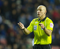 WIGAN, ENGLAND - Sunday, January 2, 2011: Referee Howard Webb, who was awarded an MBE in the New Year's Honours List, takes charge of Wigan Athletic versus Newcastle United during the Premiership match at the JJB Stadium. (Pic by: David Rawcliffe/Propaganda)