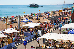 © Licensed to London News Pictures. 06/08/2020. Brighton, UK. Members of the public take to the beach in Brighton And Hove as sunny and hot weather is hitting the seaside resort. Photo credit: Hugo Michiels/LNP