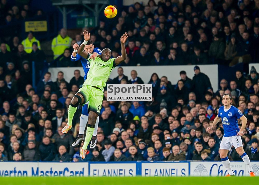 Everton defender Ramiro Funes Mori challenge for a header with Manchester City midfielder Yaya Toure
