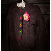 A simple knit sweater that both kids loved to wear. The colored buttons and flower seemed to coordinate with just about everything.