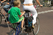 mother with a special children's cycle attached to the back of the main bicycle