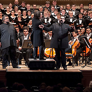 "December 12, 2012 - New York, NY : Conductor Gustavo Dudamel, foreground center, leads the  Westminster Symphonic Choir and the Simón Bolívar Symphony Orchestra of Venezuela, along with tenor Idwer Álvarez, foreground left, and baritone Gaspar Colón, foreground right, as they perform Antonio Estévez's ""Cantata criolla"" at Carnegie Hall's Stern Auditorium / Perelman Stage on Tuesday evening.  CREDIT: Karsten Moran for The New York Times"