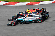 Max Verstappen of Red Bull Racing and Lewis Hamilton of Mercedes AMG Petronas battle during the Malaysian Formula One Grand Prix at the Sepang International Circuit, Malaysia.<br /> Picture by EXPA Pictures/Focus Images Ltd 07814482222<br /> 01/10/2017<br /> *** UK &amp; IRELAND ONLY ***<br /> <br /> EXPA-EIB-171001-0251.jpg
