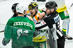 Zan Jezovsek of SZ Olimpija in fight with David Koenig of Lustenau during Ice Hockey match between HK SZ Olimpija and EHC Alge Elastic Lustenau in Semifinal of Alps Hockey League 2018/19, on April 1, 2019, in Arena Tivoli, Ljubljana, Slovenia. Photo by Vid Ponikvar / Sportida