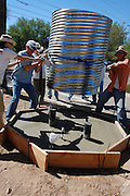 Watershed Management Group staff and volunteers move the culvert cistern into position