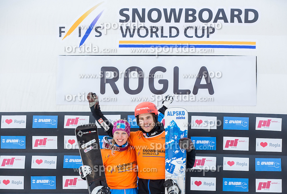Overall winners Marion Kreiner of Austria and Zan Kosir of Slovenia celebrate after the  Parallel Giant Slalom at FIS Snowboard World Cup Rogla 2015, on January 31, 2015 in Course Jasa, Rogla, Slovenia. Photo by Vid Ponikvar / Sportida