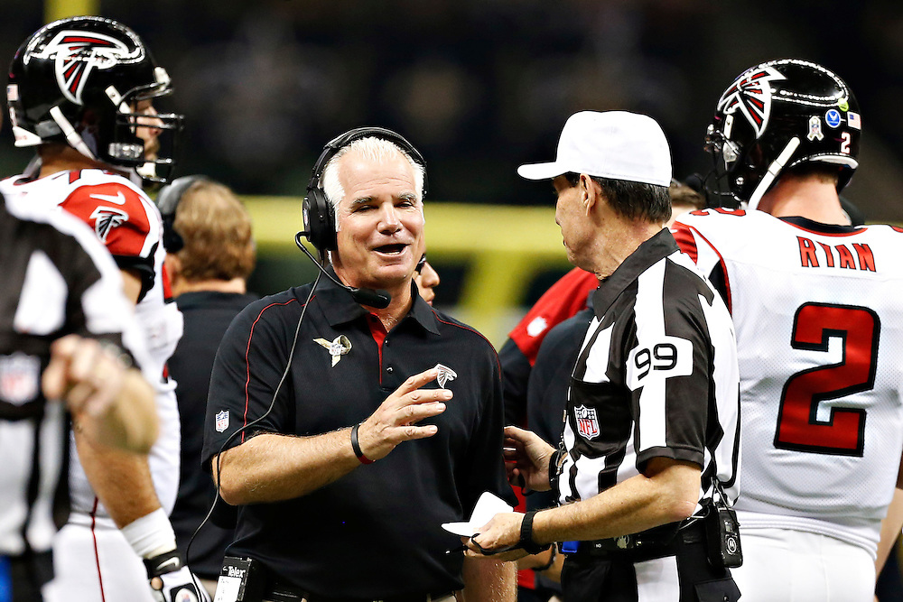 NEW ORLEANS, LA - NOVEMBER 11:  Head Coach Mike Smith of the Atlanta Falcons talks with a official during a game against the New Orleans Saints at Mercedes-Benz Superdome on November 11, 2012 in New Orleans, Louisiana.  The Saints defeated the Falcons 31-27.  (Photo by Wesley Hitt/Getty Images) *** Local Caption *** Mike Smith