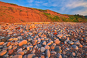 Red sandstoen cliffs and rocks along Pleasant Bay. Cape Breton Island. Cabot Trail.<br />