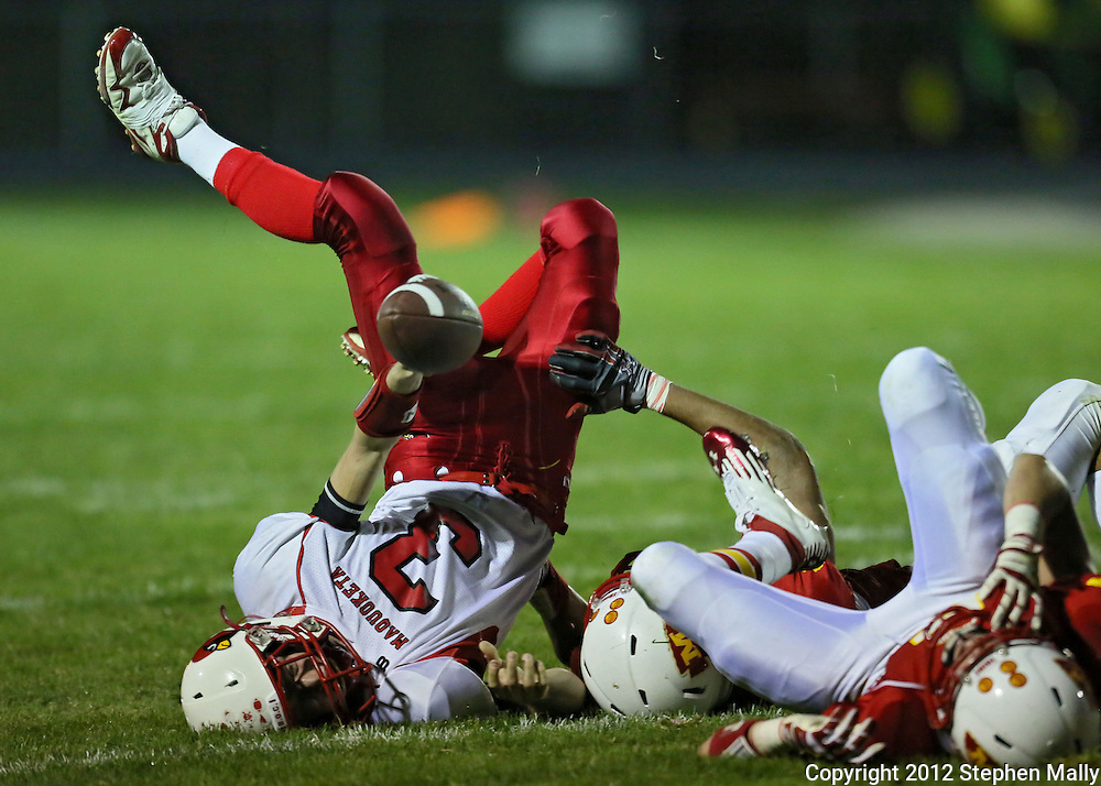 Maquoketa's Blaise Waller (3) tries to reach for a first down after being tackled by Marion's Isaac Frazier (80) during the first half of the game between Maquoketa and Marion at Thomas Park Field in Marion on Friday, September 21, 2012.