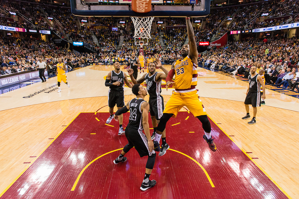 CLEVELAND, OH - JANUARY 30: LeBron James #23 of the Cleveland Cavaliers shoots over Kawhi Leonard #2 and Danny Green #14 of the San Antonio Spurs during the third quarter at Quicken Loans Arena on January 30, 2016 in Cleveland, Ohio. The Cavaliers defeated the Spurs 117-103. NOTE TO USER: User expressly acknowledges and agrees that, by downloading and/or using this photograph, user is consenting to the terms and conditions of the Getty Images License Agreement. Mandatory copyright notice. (Photo by Jason Miller/Getty Images) *** Local Caption ***LeBron James; Kawhi Leonard; Danny Green