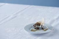 Used tea bag on saucer on table