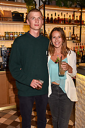 Milo Smith and Ella Mountbatten at a party to celebrate the launch of Hans' Bar & Grill, 11 Cadogan Gardens, Chelsea, London, England. 07 June 2018.