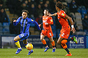 Gillingham midfielder Elliott List (15) attacking, Wycombe Wanderers defender Sido Jombati and Wycombe Wanderers defender Joe Jacobson, during the EFL Sky Bet League 1 match between Gillingham and Wycombe Wanderers at the MEMS Priestfield Stadium, Gillingham, England on 15 December 2018.