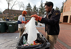Ryan Grant, right, and Nick Lorax at work during Garbology on Red Square, where grash from different locations is sorted to determine how much is recycleable or compostable at PLU on Tuesday, March 17, 2015. (Photo: John Froschauer/PLU)