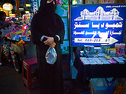 05 JULY 2011 - BANGKOK, THAILAND:   A woman from the Middle East on Soi Arab in Bangkok. Soi Arab is an alleyway in Bangkok. What started as an alley has now grown into a neighborhood that encompasses several blocks of restaurants, hotels and money exchanges that cater to Middle Eastern visitors to Thailand. The official name of the street is Sukhumvit Soi 3/1, located in North Nana between Sukhumvit Soi 3 and Sukhumvit Soi 5, not far from the Nana Plaza night-life area and the Grace Hotel popular among Arabs.   PHOTO BY JACK KURTZ