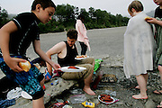 From left (front), Cory Hall, 8, and Javan Saffell enjoy a barbecue along the Eel River in Scotia, CA on Tuesday, June 27, 2006. The Halls are the fourth generation of their family to grow up in Scotia. The town of Scotia in Northern California is a company town owned by the Pacific Lumber Company (PALCO), but that will change as the company will begin to sell the town. (Photo by Max Whittaker for The New York Times)<br />