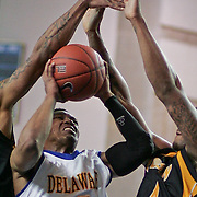Senior Guard (#3) Jawan Carter attempts to drive to the hoop in the second half. Delaware defeated Towson 80-70 at The Bob Carpenter Center Wednesday night In Newark Delaware.