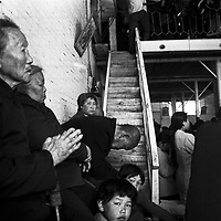 LIUJIAZHUANG VILLAGE, 15 APRIL 2001: underground catholics pray during the easter Mass in a factory building. China cut relations with the vatican in the early fifites and since then, established a Patriotic catholic Church that's controlled by Chinese authorities.<br />