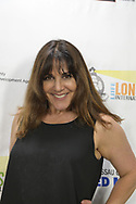 "Bellmore, New York, USA. 19th July 2017. Actress MAGGIE WAGNER, who stars as the title character in the short film ""Mom"" poses at The Long Island International Film Expo LIIFE 2017. The film is about Mom, a rabble-rousing woman who attempts to improve her unsatisfying reality."