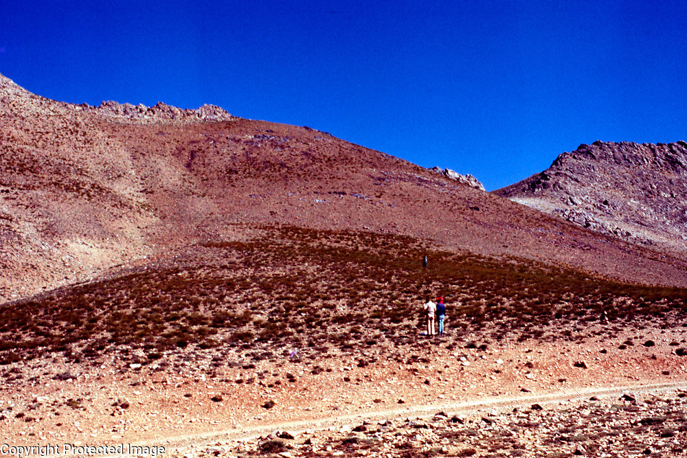 6 August 1976<br /> The slope on the left of the road is barren and very rocky. <br /> Photo: Louis Dupree