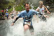 Thousands of competitors at the 2009 annual Dovedale Dash brave the weather to run through the river and the muddy fields.<br />