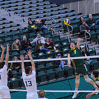 1st year right-side hitter Matthew Aubrey (7) of the Regina Cougars in action during the Men's Volleyball Home Game vs Trinity Western  on October 28 at the CKHS University of Regina. Credit Matt Johnson/Arthur Images