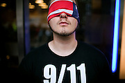 An activist demanding information and more transparency about 9/11 is campaigning on the street in Lower Manhattan, New York, USA, on the 10th anniversary of the 9/11 attacks on the Word Trade Centre.