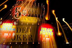 """5 Cent Video Poker"" - These slot machines were photographed in a casino in Downtown Reno, Nevada. The effect was obtained in camera by long exposure mixed with intentional camera movement."
