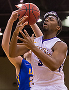 UMHB's Daniel Mills (3) has his glasses knocked off via a basketball smashing into his face while working against LeTourneau's Zack Walker during game action at the Mayborn Campus Center at the University of Mary Hardin-Baylor in Belton on Thursday, Jan. 7, 2016.