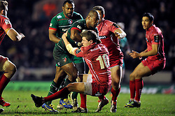 Seremaia Bai of Leicester Tigers takes on the Scarlets defence - Photo mandatory by-line: Patrick Khachfe/JMP - Mobile: 07966 386802 16/01/2015 - SPORT - RUGBY UNION - Leicester - Welford Road - Leicester Tigers v Scarlets - European Rugby Champions Cup