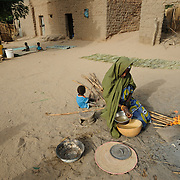 Adama Garba prepares the evening meal at her home in the village of  Nakaidabo in the Tessaoua region of Niger. She has only a few handfuls of beans and a pinch of salt to feed her family of seven.