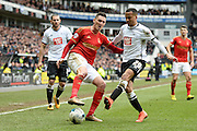 Nottingham Forest striker Federico Macheda   battles with with Derby County defender Marcus Olsson during the Sky Bet Championship match between Derby County and Nottingham Forest at the iPro Stadium, Derby, England on 19 March 2016. Photo by Jon Hobley.